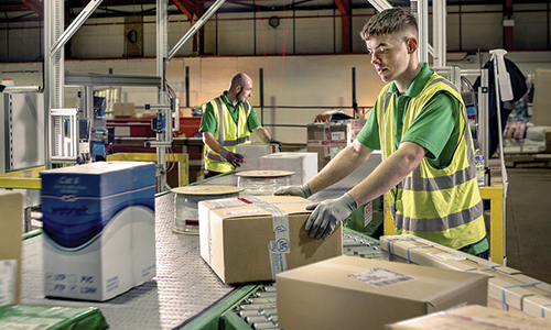 Tuffnells employee sorting parcels