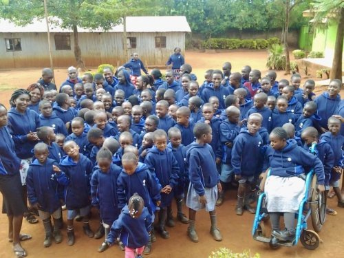 The children of Aquinoe in their new hoodies.